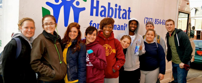 Students attend a Habitat Humanity service trip.