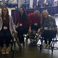Group picture of some of the PTA class of 2017 playing wheelchair basketball with the instructor at the 2016 Abilities Expo. L to R: Beth Auld ('17), Hannah Simmons ('17), Kristina Florio ('17), Instructor/presenter at the Expo, Serra Wildman ('17)