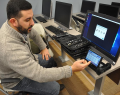 Professor Brandon Catalan in Salve's new digital forensics lab